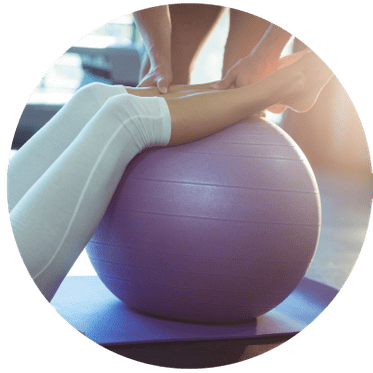 woman doing exercise with a ball