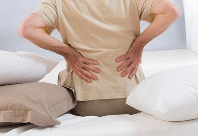 individual suffering from back pain